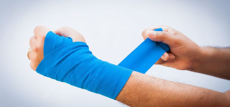 37885992 - close-up of male bandaging his arm